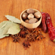 Nutmeg and other spices on wooden background — Stock Photo #20317663