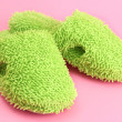 Bright slippers, on pink background - Lizenzfreies Foto