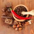Chocolate sweets, mortar with coffee beans on wooden background — Stock Photo #20318611
