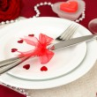 Table setting in honor of Valentine's Day close-up — Stock Photo #20318747