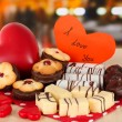 Sweet cookies with hearts and valentine card on table in cafe — Stock Photo