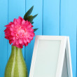 White photo frame for home decoration on blue background — Stock Photo #20319469