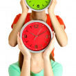 Girls holding clocks over face isolated on white — Stock Photo