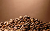 Coffee beans on brown background — Stock Photo