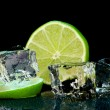 Stock Photo: Ice cubes with lime on darck background