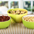 Delicious and healthy cereal in bowls on table in room - Stock Photo