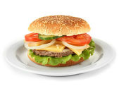 Tasty cheeseburger on plate, isolated on white — Stock Photo