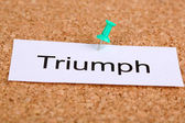 Push pin on paper with word triumph on cork board — Stock Photo