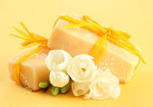 Natural handmade soap, on yellow background — Stock Photo
