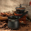 Stock Photo: Coffee grinder, turk and cup of coffee on burlap background