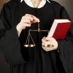 Judge on black background — Stock Photo