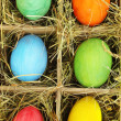 Easter eggs in wooden basket close up — Stockfoto