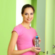 Young girl in locker room with bottle of water — Stock Photo #20405449
