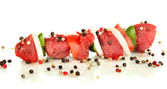 Raw beef meat and vegetables on skewer isolated on white — Stock Photo