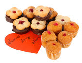 Sweet cookies with valentine card isolated on white — Stock Photo