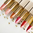 Beautiful lipsticks, isolated on white — ストック写真