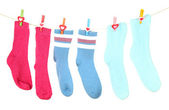 Colorful socks hanging on clothesline, isolated on white — Stock Photo