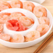 Prawns on plate with chopsticks and sauce — Stock Photo #20662353