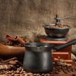 Coffee grinder, turk and cup of coffee on burlap background — Foto Stock