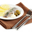 Royalty-Free Stock Photo: Dish of herring and lemon on plate isolated on white