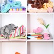 Beautiful white shelves with different baby related objects — Stock Photo #20662625