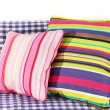Colorful pillows on couch isolated on white - Foto Stock