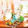 Dried oranges, wicker balls and other home decorations in glass bowl, on bright background — ストック写真
