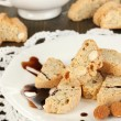 Aromatic cookies cantuccini and cup of coffee on wooden table close-up — Stock Photo