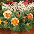 Royalty-Free Stock Photo: Christmas wreath decorated with rose from dry orange peel on wooden table