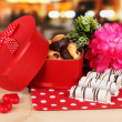 Sweet cookies in gift box on table in cafe — Stock Photo #20664077