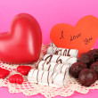 Sweet cookies with hearts and valentine card on pink background — Stock Photo