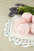 Marshmallows on plate on light background — Stock Photo