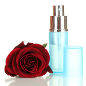 Women's perfume in beautiful bottle with rose isolated on white — Stock Photo