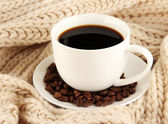 Cup of coffee with scarf close-up — Stock Photo