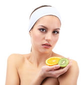 Young woman with fruit.Concept: Facial fruit masks. Isolated on white — Stock Photo