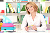 Young beautiful business woman in office at her workplace — Stock Photo