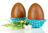 Chocolate eggs in napkin isolated on white — Stock Photo