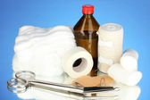 First aid kit for bandaging on blue background — Stock Photo