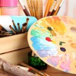 Artistic equipment: paint, brushes and art palette - Lizenzfreies Foto