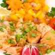 Appetizing sliced salmon with lemon and vegetables close up — Stock Photo