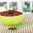 Delicious and healthy cereal in bowl on table in room - Stock Photo