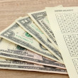Stock Photo: Lottery ticket and money, on wooden background
