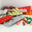 Colorful pills and capsules on shelf - ストック写真