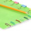 Green paper with binder and paper clips  close up - Stock Photo