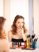 Portrait of attractive woman applying parfume — Stock Photo