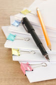 Documents with binder clips on wooden table — Stok fotoğraf