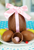 Composition of Easter and chocolate eggs on window background — Stock Photo