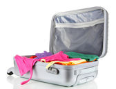 Open silver suitcase with clothing isolated on white — Foto de Stock