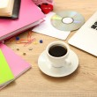 Cup of coffee on office desktop close-up - Stock Photo