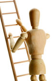 Mannequin on wooden ladder, isolated on white — Stock Photo